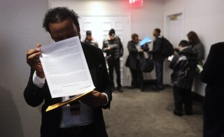 Applicants wait in line to meet potential employers at the Diversity Job Fair in 2012 in New York City. Photo by John Moore/Getty Images
