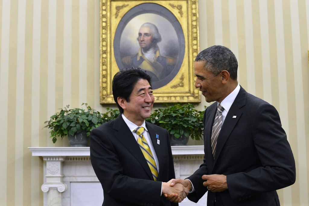Japanese Prime Minister Shinzo Abe and President Barack Obama shake hands in the White House's Oval Office on Feb. 22, 2013. As part of his four-nation Asia tour, Obama will attempt to convince Abe and other Japanese leaders Thursday that he can deliver on security promises as tensions rise in the region. Photo by Jewel Samad/AFP/Getty Images