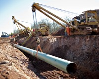Coast Project pipeline in Prague, Oklahoma, U.S. in March 2013. The Gulf Coast Project, a 485-mile crude oil pipeline being constructed by TransCanada Corp., is part of the Keystone XL Pipeline Project and will run from Cushing, Oklahoma to Nederland, Texas. Photo by Daniel Acker/Bloomberg via Getty Images