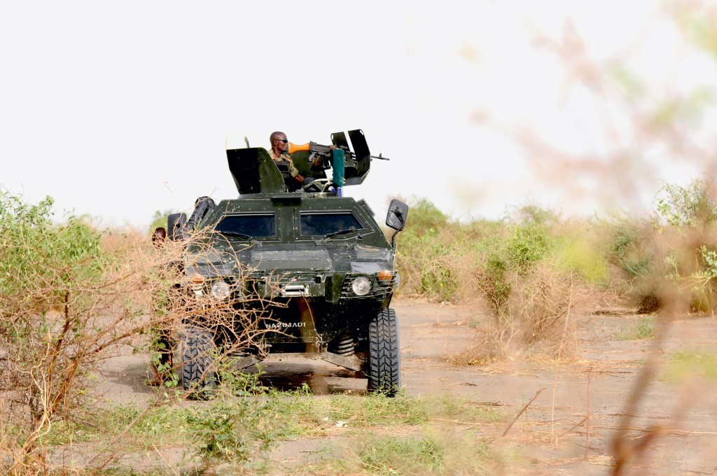 Nigerian soldiers patrol in the north of Borno state close to a Islamist extremist group Boko Haram former camp near Maiduguri in this June 5, 2013 file photo. Photo by Quentin Leboucher/AFP/Getty Images