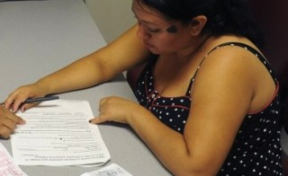182609341-image-of-person-trying-to-enroll-for-health-insurance-900x450