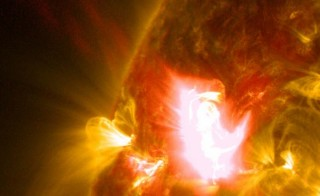 A mid-level flare, an M6.5, erupted from the sun on April 2, 2014, peaking at 10:05 a.m. EDT. This image from NASA's Solar Dynamics Observatory shows the flare in a blend of two wavelengths of extreme ultraviolet light: 131 Angstroms and 171 Angstroms, colorized in yellow and red, respectively.