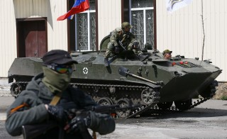 A Russian flag is seen on top of an armoured personnel carrier in Slaviansk