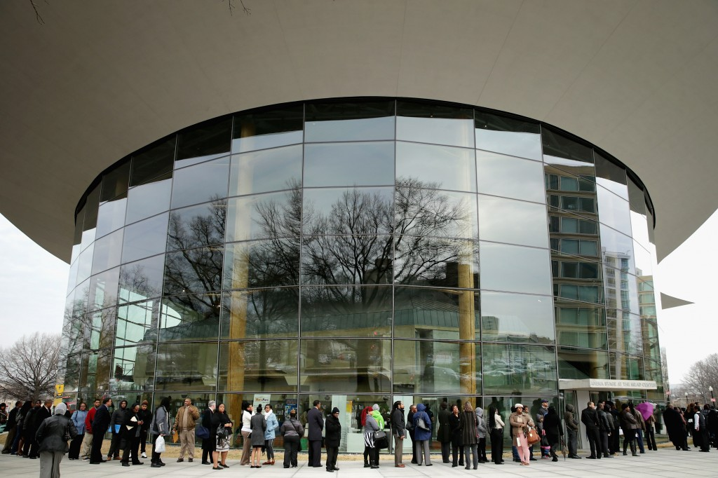 About 1,500 people seeking employment wait in line to enter a job fair outside the Arena Stage at the Mead Center for American Theater March 28 in Washington, D.C.  Photo by Chip Somodevilla/Getty Images