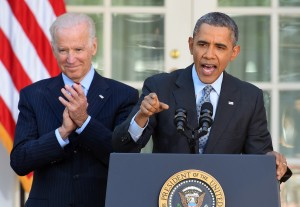 President Obama is accompanied by Vice President Biden as he delivers a statement on the Affordable Care Act in the White House Rose Garden Tuesday.  Photo by JEWEL SAMAD/AFP/Getty Images