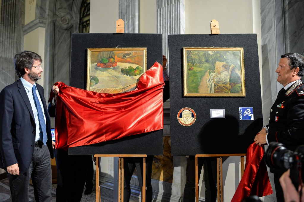 Italian officials unveil the recently recovered post-Impressionist works of Paul Gauguin and Pierre Bonnard. Photo by ANDREAS SOLARO/AFP/Getty Images