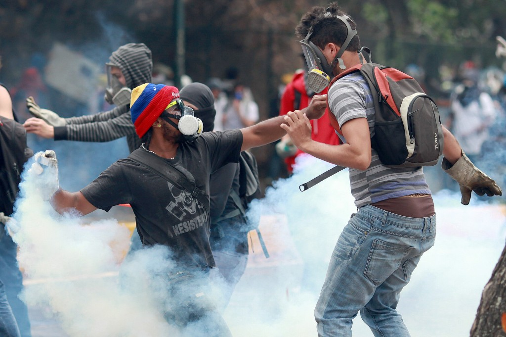 Opposition students protest against the government of Venezuelan President Nicolas Maduro at the Venezuelan Central University (UCV) campus in Caracas, on April 3, 2014. Photo by Federico Parra/AFP/Getty Images
