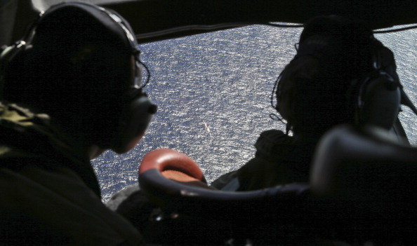 Wing commander Rob Shearer captain of the RNZAF P3 Orion (L) and SGT Sean Donaldson look out the cockpit windows during search operations for missing Malaysia Airlines Flight MH370 in Southern Indian Ocean on April0 4, 2014, near Australia. Up to fourteen planes and nine ships resumed in the search for missing Malaysia Airlines flight MH370 in the Indian Ocean off the coast of Western Australia today. The airliner disappeared on March 8 with 239 passengers and crew on board and is suspected to have crashed into the southern Indian Ocean. (Photo by Nick Perry - Pool/Getty Images)