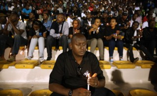 Rwandans hold a candle light vigil at Amahoro Stadium during the 20th anniversary commemoration of the 1994 genocide April 7, 2014 in Kigali, Rwanda. Photo by Chip Somodevilla/Getty Images