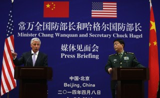 Defense Secretary Chuck Hagel, left, and Chinese Minister of Defense Chang Wanquan, right, participate in a joint news conference at the Chinese Defense Ministry headquarters April 8, 2014 in Beijing, China. Secretary Hagel is on the second stop of an Asian trip, the fourth time since he took office, to Japan, China and Mongolia. Photo by Alex Wong/Getty Images