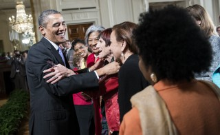 President Barack Obama is hugged by Rep. Rosa L. DeLauro ,D-CT, following an equal pay event in the White House in 2014. Obama designated the Sewall-Belmont House, which played a role in the U.S. women's suffrage movement, as a national monument Tuesday. Photo by Brendan Smialowski/AFP/Getty Images