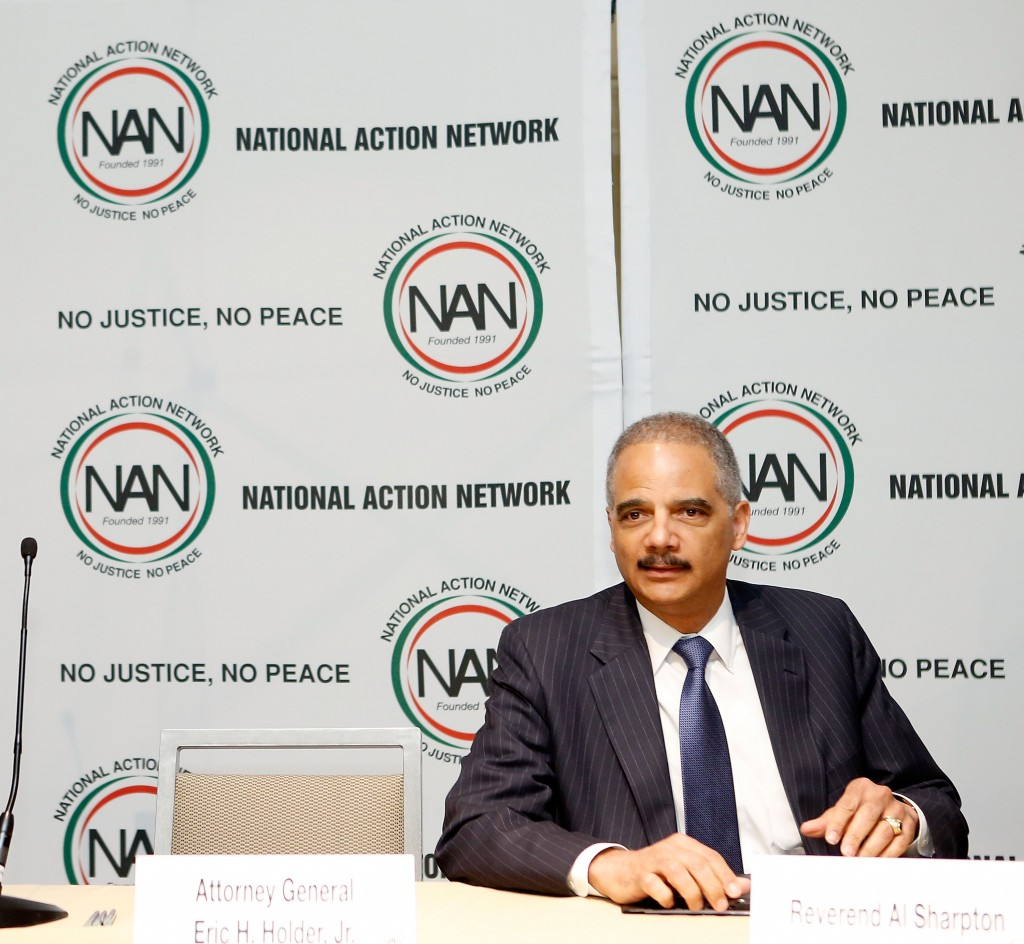 "Attorney General Eric Holder told the audience at the annual National Action Network convention in New York April 9 that he and the president had faced ""ugly and divisive adversity."" Photo by J. Countess/Getty Images"