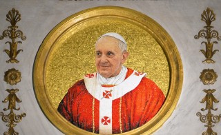 A picture shows a mosaic representing Pope Francis on April 10, 2014 at the Basilica of Saint Paul Outside the Walls. (San Paolo Basilica). Photo by Andres Solaro/Getty Images