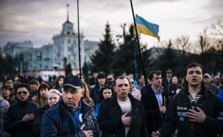 People sing the Ukrainian national anthem  during a pro-Ukraine rally in the eastern Ukrainian city of Lugansk on April 15, 2014. Photo by DIMITAR DILKOFF/AFP/Getty Images