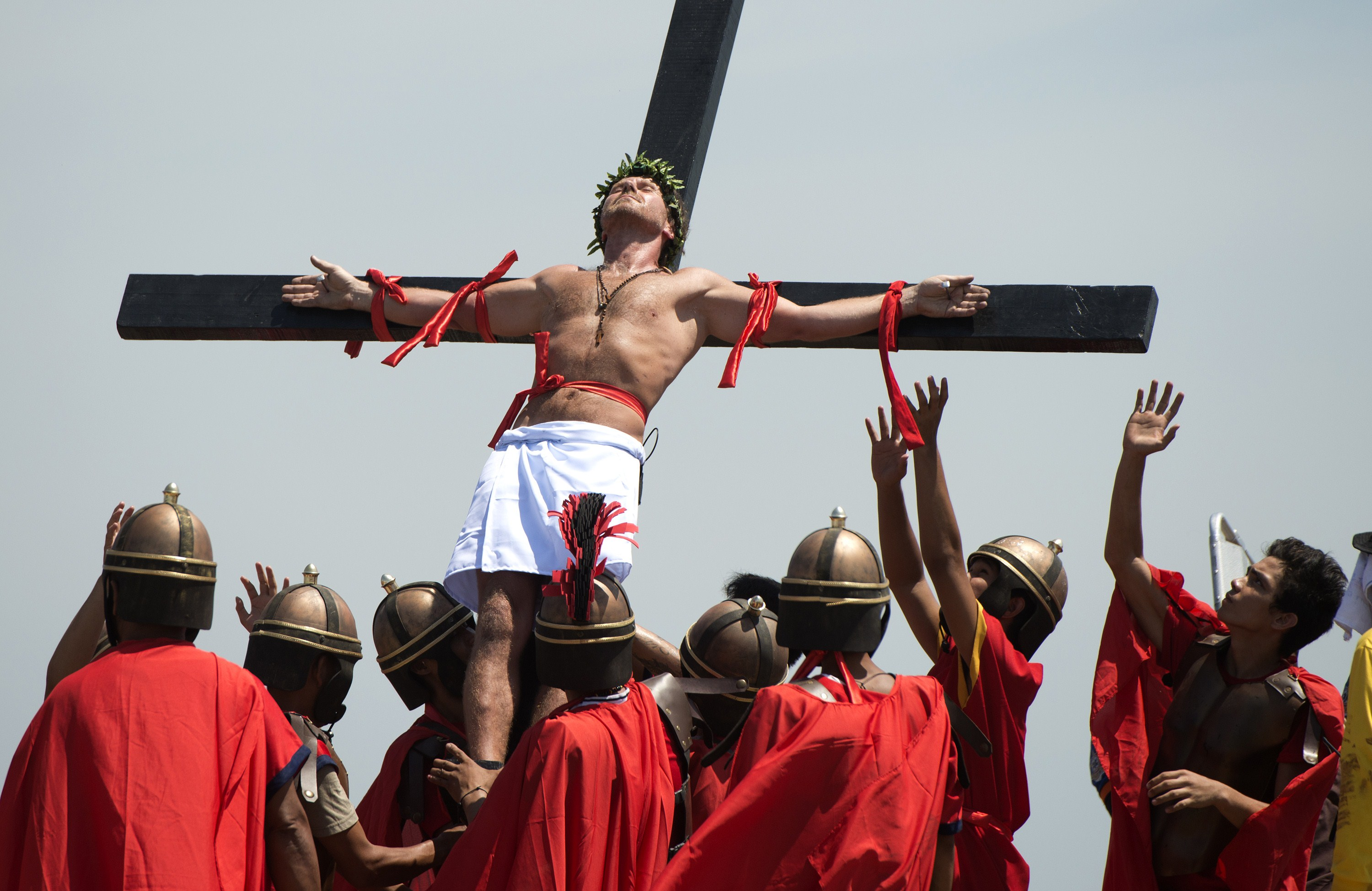 Danish film maker Lasse Spang Olsen is nailed to a cross during the a re-enactment of the Crucifixion of Christ during Good Friday celebrations in Cutud, Pampanga, north of Manila on April 18, 2014.  Eight Filipinos and a Dane re-enacted the death of Jesus Christ on Friday by nailing themselves to crosses before thousands of people in a gruesome annual Easter spectacle in the Philippines. Photo by Noel Celis/AFP/Getty Images