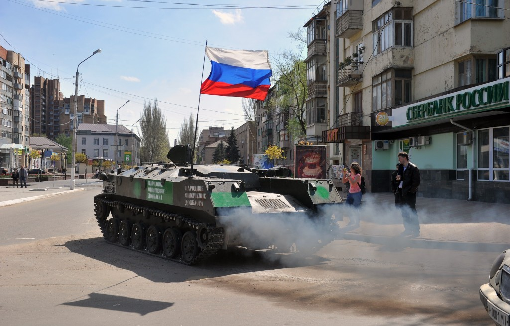 An armored personnel carrier with a Russian flag drives outside the regional administration building in the eastern Ukrainian city of Slavyansk Monday. Photo by GENYA SAVILOV/AFP/Getty Images