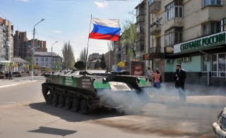 An armoured personnel carrier with a Russian flag drives outside the regional administration building in the eastern Ukrainian city of Slavyansk Monday. Photo by GENYA SAVILOV/AFP/Getty Images