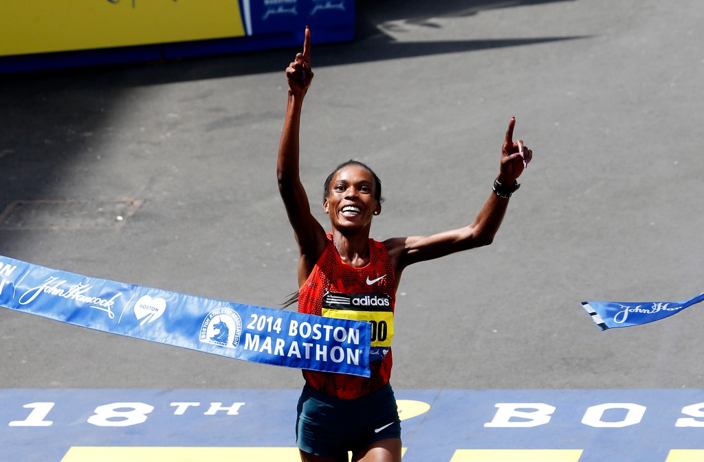 Rita Jeptoo of Kenya crosses the finish line to win the 118th Boston Marathon on April 21, 2014 in Boston. Photo by Jim Rogash/Getty Images