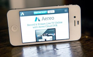 In this photo illustration, Aereo.com, a web service that provides television shows online, is shown on an iPhone 4S. After losing a court case earlier this year, the company's CEO announced Friday that Aereo filed for Chapter 11 bankruptcy, ending a three-year mission to shake up the traditional broadcast model. Photo Illustration by Andrew Burton/Getty Images