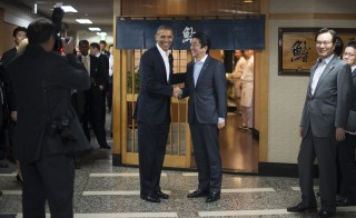 President Barack Obama shakes hands with Japanese Prime Minister Shinzo Abe before a private dinner at Sukiyabashi Jiro restaurant in Tokyo. Photo by Jim Watson/AFP/Getty Images