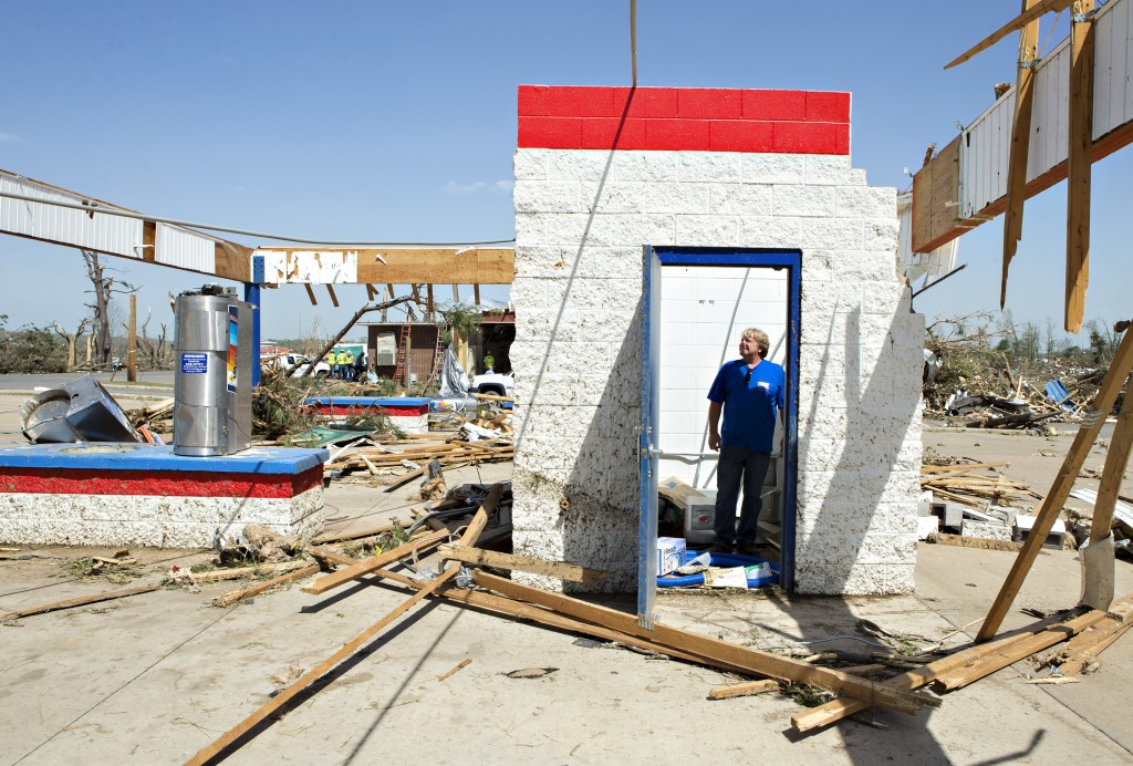 Ken Sullivan, general manager of We Willies Super Auto Wash, looks over the damage after a tornado tore through the area for the second time in three years, on April 28, 2014 in Vilonia, Arkansas. Photo by Wesley Hitt/Getty Images