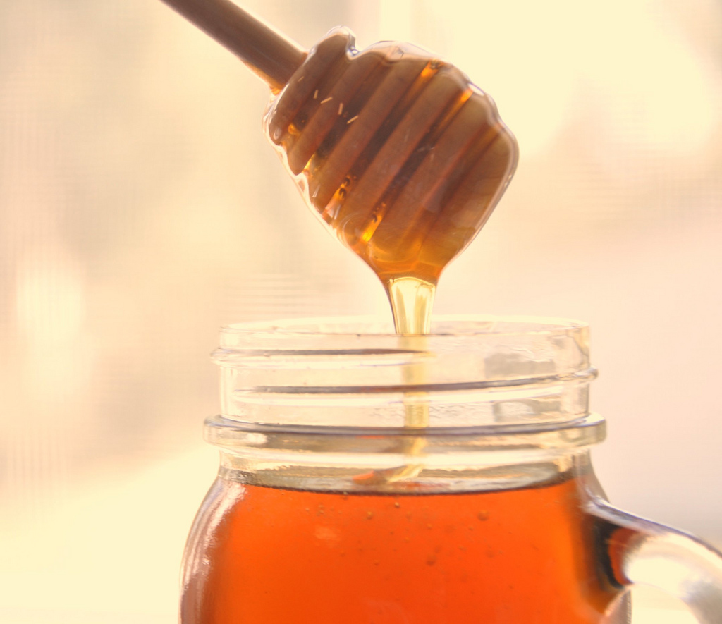 "Under proposed FDA guidelines, food companies would no longer be allowed to add sugar or other sweeteners to pure honey and still call it ""honey"". Photo by Flickr user Beeyond the Hive"