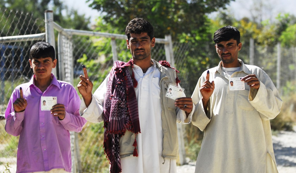 Participants in 2010's Afghan parliamentary election hold up proof that they voted. Elections to be held April 5 have inspired a wave of Taliban-led violence. Photo by Sgt. Katryn McCalment