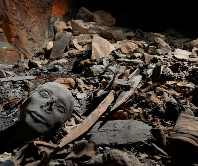 A death mask is seen in the foreground of this photo from the burial site. Photo by Matjaz Kacicnik, University of Basel/Egyptology