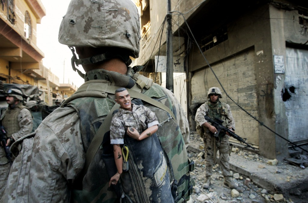 In Sunday, Nov. 14, 2004 file photo, a U.S. Marine of the 1st Division carries a mascot for good luck in his backpack as his unit pushed further into the western part of Fallujah, Iraq, Sunday, Nov. 14, 2004. Photo by Anja Niedringhaus/AP