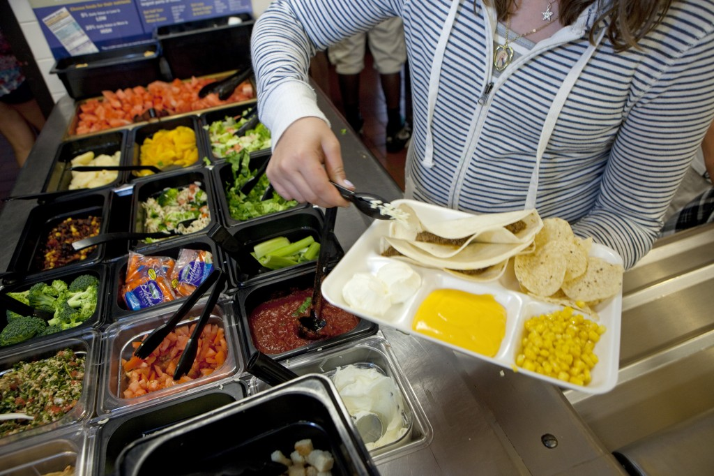 Students at Doherty Middle School get their healthy lunch at the school cafeteria, on June 18, 2012 in Andover, Massachusetts. Some schools are concerned new guidelines only mean more healthy food will end up in the trash. Photo by Melanie Stetson Freeman/The Christian Science Monitor via Getty Images