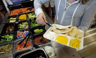 Students at Doherty Middle School get their healthy lunch at the school cafeteria, on June 18, 2012 in Andover, Massachusetts. Photo by Melanie Stetson Freeman/The Christian Science Monitor via Getty Images