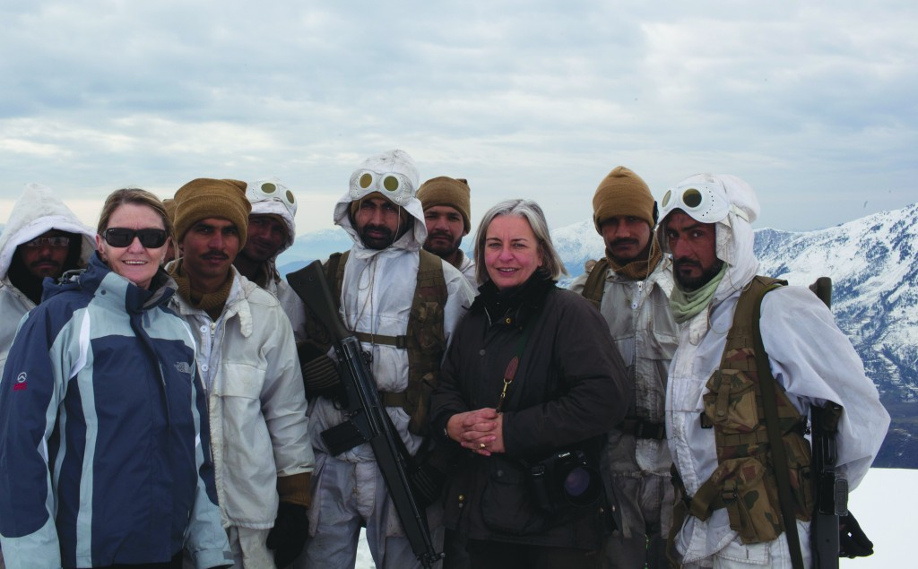 Kathy Gannon, left, AP special correspondent for Afghanistan and Pakistan, and veteran AP photographer Anja Niedringhaus pose with Pakistani soldiers in the remote border area opposite Afghanistan's northeastern Kunar province, circa 2012. The AP team was documenting Pakistan's role in fighting Islamic militants in the region.