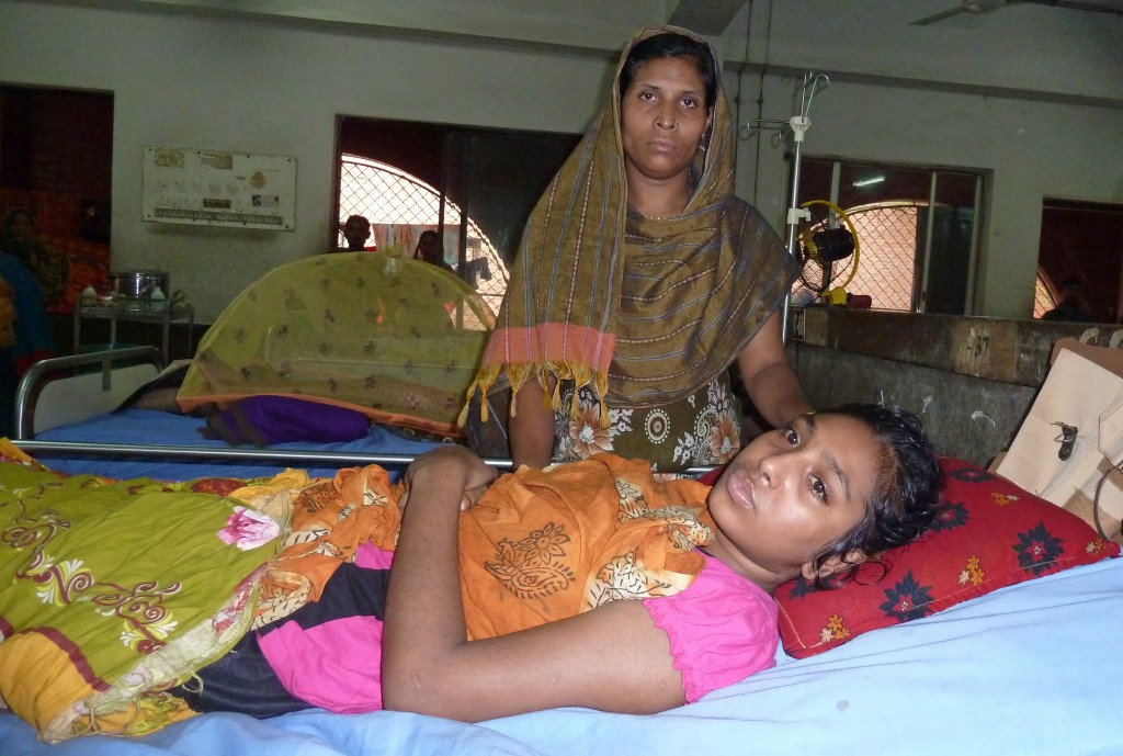 Josna Akter, one of the survivors of the Rana Plaza garment factory collapse in Greater Dhaka, Bangladesh, recovers in a hospital with her mother in June 2013. Photo by Fred de Sam Lazaro