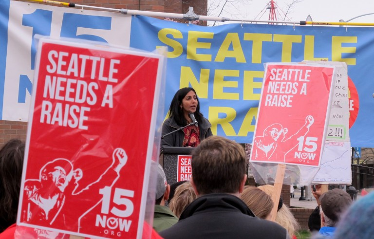 Seattle City Council member Kshama Sawant, center, is fighting to bring a $15 an hour minimum wage to all workers in the city. Photo by Flickr user Shannon Kringen.