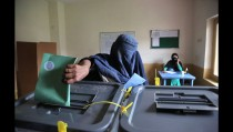 An Afghan woman casts her vote at a polling station in Jalalabad east of Kabul, Afghanistan, Saturday, April 5, 2014