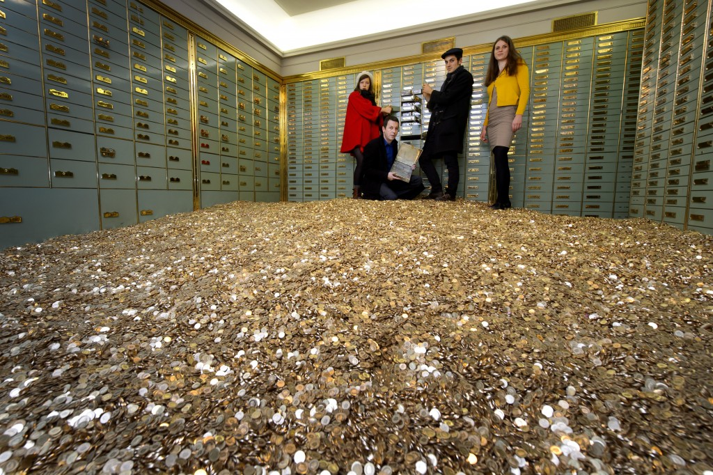 Could America ever seriously entertain a guaranteed basic income? Above, members of 'Generation Basic Income' in Switzerland post with 8 million Swiss coins after securing a ballot referendum on an uncondition basic income. Photo by FABRICE COFFRINI/AFP via Getty Images.