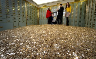 Could America ever seriously entertain a guaranteed basic income? Above, members of 'Generation Basic Income' in Switzerland post with 8 million Swiss coins after securing a ballot referendum on a universal basic income. Photo by FABRICE COFFRINI/AFP via Getty Images.
