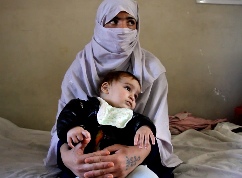 "Soheila, with her child, is imprisoned in Afghanistan. Image from the documentary ""To Kill a Sparrow"""
