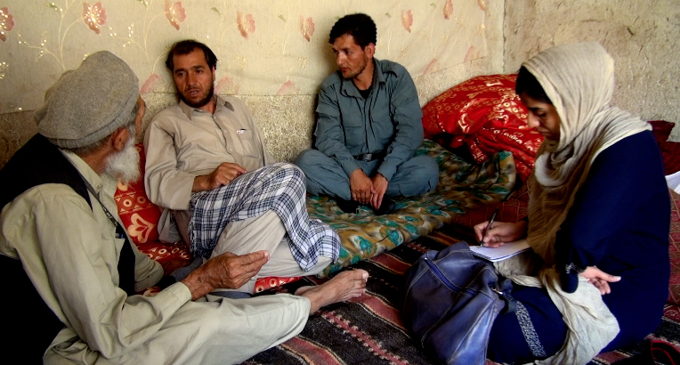 "Photojournalist Zohreh Soleimani interviews the family of a woman who was imprisoned for adultery in Afghanistan. Image from documentary ""To Kill a Sparrow"""