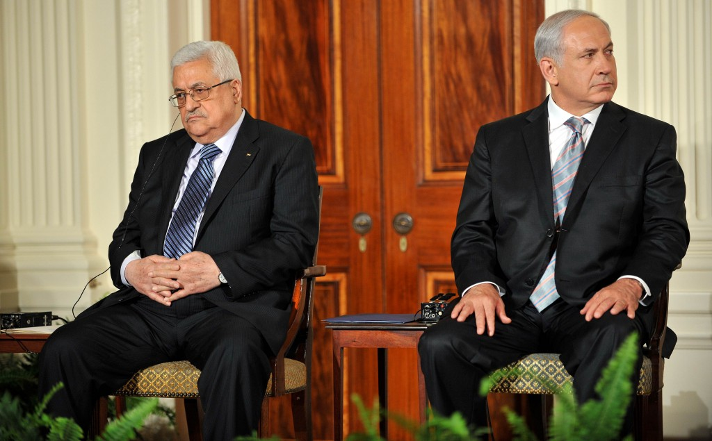 Prime Minister Benjamin Netanyahu of Israel sits next to President Mahmoud Abbas of the Palestinian Authority, left,  at the White House in Sept., 2010. Photo by TIM SLOAN/AFP/Getty Images