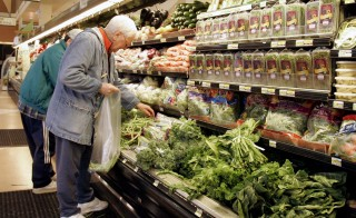 Customers shop at a supermarket in Chicago Tuesday, April 29, 2008. AP Photo/Charles Rex Arbogast