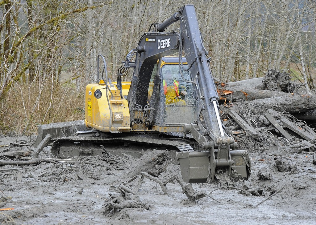 An excavator works in the debris field near Oso, Wash. Photo courtesy of Washington State Patrol
