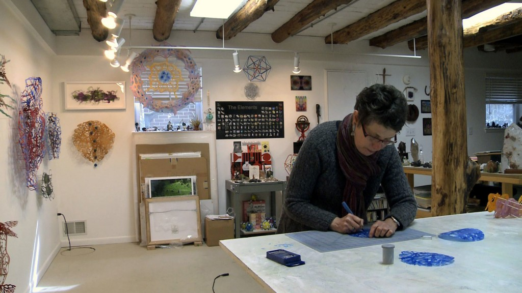 Rebecca Kamen works in her studio in McLean, Va. Still by Ellen Rolfes/PBS NewsHour