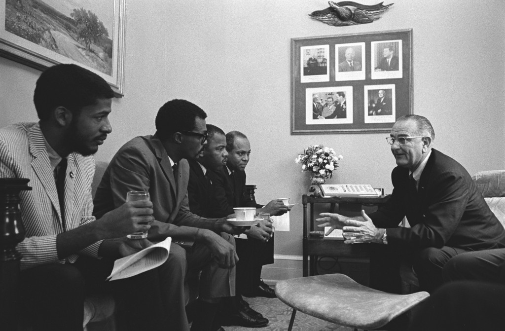 President Lyndon B. Johnson, right, speaks with four civil rights activists, including John Lewis and James Farmer. Photo by Yoichi Okamoto