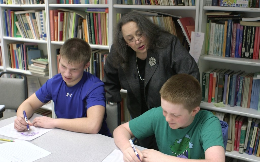 Marilyn Zecher, a language specialist at the Atlantic Seaboard Dyslexia Education Center in Rockville, Maryland works with Alec Falconer and Sam XXX learn cursive writing to deal with their dyslexia.  Photo by: Mike Fritz/PBS NewsHour