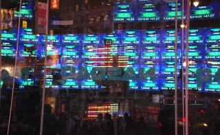 "Michael Lewis' new book ""Flash Boys"" is just the latest critique of high-frequency trading. Photo of the Nasdaq MarketSite from Times Square by Flickr user Adam Fagen."