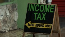 Income Tax -- Rapid Refund Here sign