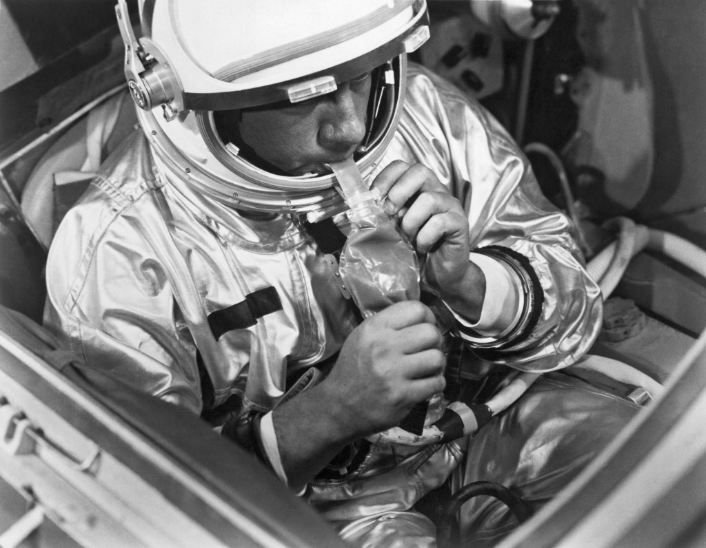 Space food has come a long way since 1966 when this photo was taken of a NASA test subject consuming a meal of pot roast and gravy through a feeding tube pack aboard a Gemini spacecraft mockup. Photo by Underwood Archives/Getty Images