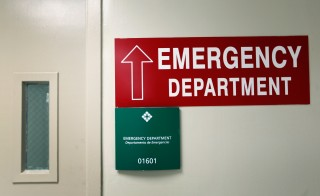 A sign giving direction to The University of Miami Hospital's Emergency Department hangs on a wall on April 30, 2012 in Miami, Florida. Photo by Joe Raedle/Getty Images