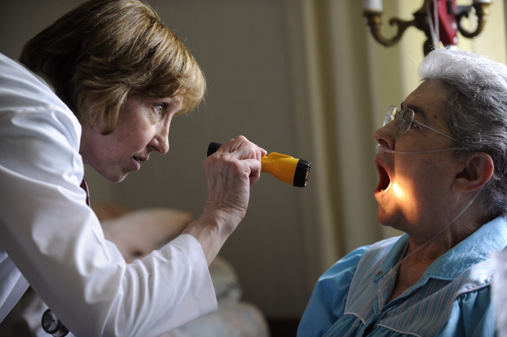 Hospice nurse Cathe Ferguson checks for signs of thrush inside Rosemary's mouth. Photo By Kathryn Scott Osler/The Denver Post via Getty Images